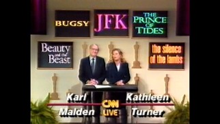 Live on CNN, Karl Malden and Kathleen Turner announce the nominees for the 1991 Academy Awards Best Picture, with Turner mispronouncing producer Don Hahn's surname in this rare piece of pillarboxing.