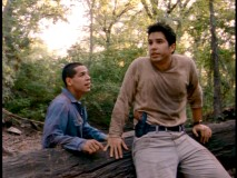 Escaped prisoner Hector (Greg Serano) and Detective Sandoval catch their breath while evading the authorities.