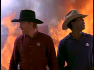 The upside of there being no extras? You get another gnarly show picture. As always, Walker and Trivette are at a minimally safe distance from danger. Here, they stand heroically in front of a major fire.