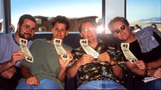 "In ""The Pixar Story"", four of the studio's leading filmmakers (Joe Ranft, Pete Docter, John Lasseter and Andrew Stanton) proudly display their checked luggage tags on a mid-'90s flight to Disney."