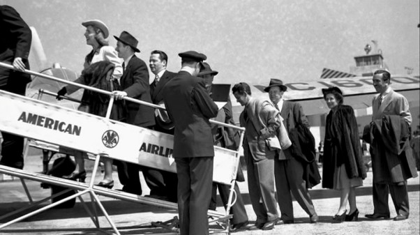 Walt and El Grupo board an American Airlines plan to return to California, or else they're simply staging that effect.