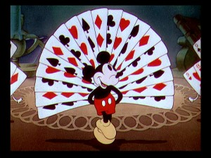 "Mickey shows off his red, white, and black tail thanks to the living playing cards of ""Thru the Mirror."""
