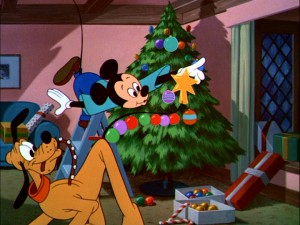 "Mickey Mouse and Pluto decorate their boughs of holly with colorful balls and a gold star in 1952 short ""Pluto's Christmas Tree."""