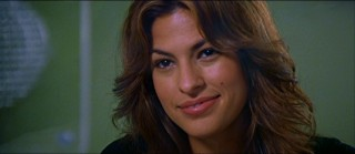 Eva Mendes shows off her smile and cheek mole as Wendell's love interest Doreen.