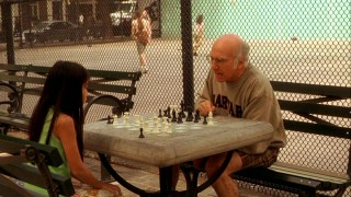 Boris (Larry David) berates one of his chess students for not making a smart move.