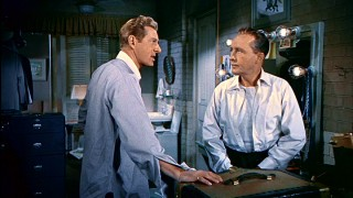 Soldiers turned music sensations Phil Davis (Danny Kaye) and Bob Wallace (Bing Crosby) have a little backstage argument over their busyness.