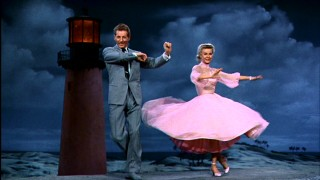 "Mutually smitten performers Phil (Danny Kaye) and Judy (Vera-Ellen) demonstrate ""The Best Things Happen When You're Dancing"" by a genuine Florida lighthouse."