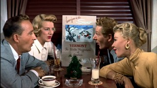 In the dining car of a train headed for Vermont, our four leads (left to right, Bing Crosby, Rosemary Clooney, Danny Kaye, and Vera-Ellen) sing of the wonders of snow.