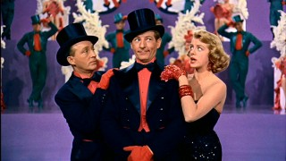 Musical jokes are in order, as Wallace (Bing Crosby), Davis (Danny Kaye), and a Haynes sister (Rosemary Clooney) perform a festive minstrel show medley.