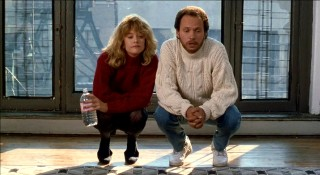 Harry and Sally admire a rug while squatting before it.