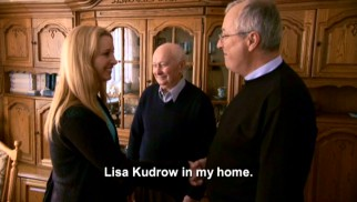 "Three generations of the Barudin family welcome their famous distant relative, Lisa Kudrow of the ""Friends"", into their Gydnia, Poland home as subtitles clarify their accented English."