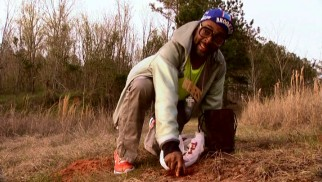 Spike Lee tastefully pays respect to his great great grandfather by digging up dirt from his land dressed like Mars Blackmon and talking like an obedient slave.
