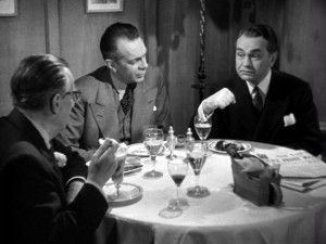 With a show of his scratched wrist, Richard suggests his own guilt to his D.A. (Raymond Massey) and doctor (Edmond Breon) friends.