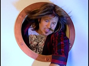 Your final visual dose of Disney Channel wackiness comes from loosely-mustachioed Robby Ray Stewart (Billy Ray Cyrus), who pokes his head out of a ship's apparently open window to be sick.