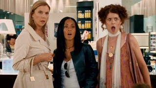 "Sylvie Fowler (Annette Bening), Alex Fisher (Jada Pinkett Smith), and Edie Cohen (Debra Messing) are blown away by the sight of ""Spritzer girl"" Crystal Allen."