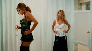 Mary (Meg Ryan) confronts her husband's mistress (Eva Mendes) while both try on lingerie in a dressing room.