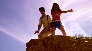 Justin (David Henrie) and Alex (Selena Gomez) use their magic hands and levitation spells on rocks to get them to the other side and one step closer to the Stone of Dreams.