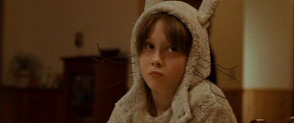 Dressed in a whiskered, hooded wolf costume, 9-year-old Max (Max Records) is not altogether happy with his home life.