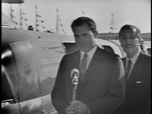 Future president Richard Nixon appears alongside Walt Disney to dedicate the newly-opening Disneyland Monorail.