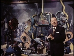 "A superimposed-looking Walt ""tours"" the sullied toy factory set from ""Babes in Toyland."""