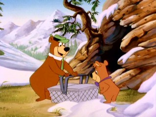 "Eager to break their winter's fast at the start of ""Yogi's Great Escape"", Yogi Bear and Boo Boo find something sweet but not so edible inside this picnic basket."