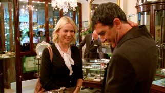 Sally Channing (Naomi Watts) enjoys modeling pricy earrings for her boss Greg (Antonio Banderas).