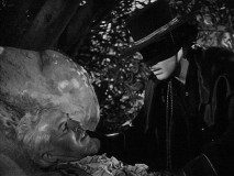 Zorro tends to his wounded father (George J. Lewis) without revealing his true identity.