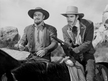 "An uncredited Jack Elam and John Doucette are outlaws who wish to play tax collector in ""Slaves of the Eagle."""
