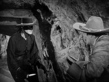 "Zorro wields a knife in an inevitable cave fight over ""The Secret of the Sierra."""