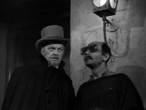 A faux-blind beggar Figueroa is part of the Magistrado's (Vinton Hayworth) secret evil plans.