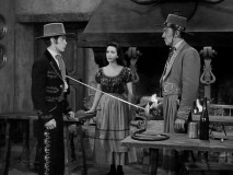 Stranger Carlos Murietta (Kent Taylor) challenges young Don Rudolfo (Steve Stevens) to a duel to the death, with waitress Maria Crespo (Myrna Fahey) in the middle of the dispute.