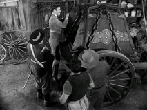 The town comes out to admire Sgt. Garcia's one thousand pound iron box, made specially for transporting tax money to the governor.