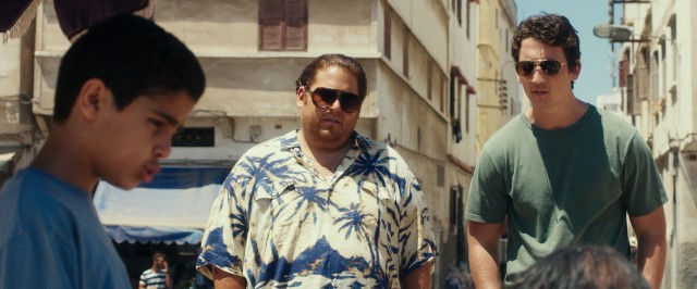 Efraim (Jonah Hill) and David (Miles Teller) soon get in over their heads arranging for arms deals in the Middle East.