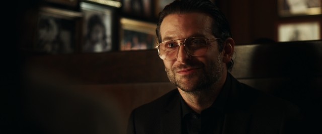 "Bradley Cooper reunites with his ""Hangover"" director both as a ""War Dogs"" producer and as scene-stealing watch-listed businessman Henry Girard."