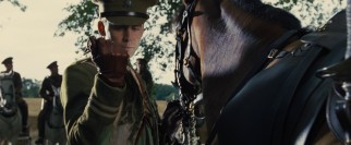 Captain Nicholls (Tom Hiddleston) admires the colored sash that comes with his new horse.