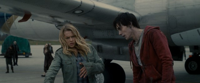 "In #41, ""Warm Bodies"", R (Nicholas Hoult) informs Julie (Teresa Palmer) that her attempt to blend in with his fellow airport runway zombies is a bit over the top."