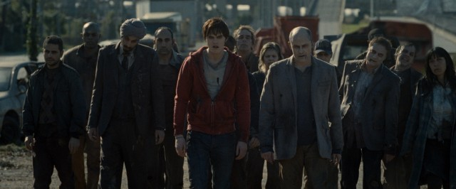 R (Nicholas Hoult) and M (Rob Corddry) lead a pack of zombies on slow but determined walk.