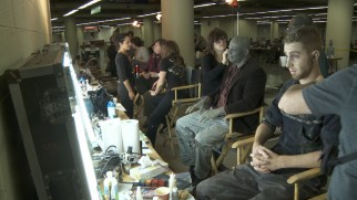 "A row of zombie extras get made-up in ""Extreme Zombie Make-Over!"""