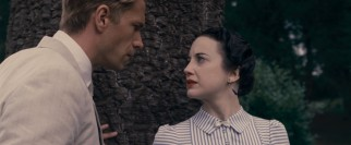 The monarchy-shaking love affair of Edward VIII (James D'Arcy) and Wallis Simpson (Andrea Riseborough) is of tremendous interest to both this film and its modern-day protagonist.