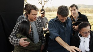 "Matt Damon, Cameron Crowe, and crew members check out playback in the feature-length documentary ""We Shot a Zoo."""
