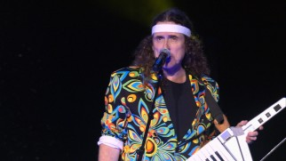 "Weird Al breaks out his headband and keytar for ""Money for Nothing/Beverly Hillbillies"", the opening part of his central medley."