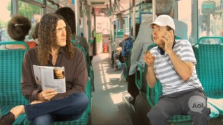 "Weird Al (left) gets bothered by a bus rider (also Weird Al) in this ""One on One"" short."