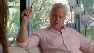 A white-haired Tim Robbins plays Alice's therapist Dr. Daryl Moffet.