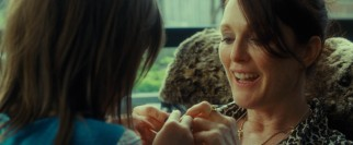 Susanna (Julianne Moore) enjoys a tender moment with her daughter.