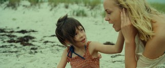 Maisie (Onata Aprile) enjoys a moment on the beach with her nanny Margo (Joanna Vanderham).