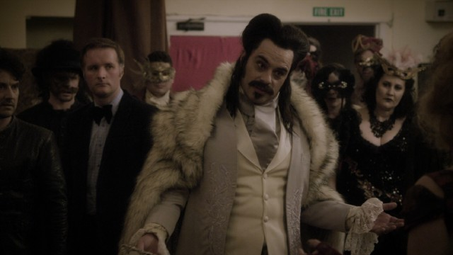 Vladislav (Jemaine Clement) makes a dramatic appearance at the annual Unholy Masquerade Ball.
