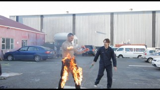 "Ben Frensham gets set on fire safely as part of a pyrotechnics test seen in ""Behind the Shadows."""