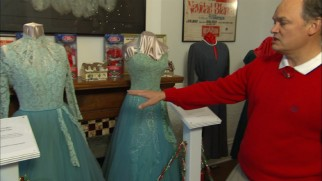"Steve Henry shows off the ""Sisters"" dresses at The Rosemary Clooney House in Augusta, Kentucky."