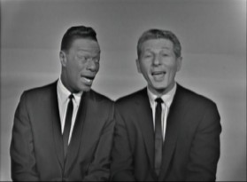"Nat King Cole and Danny Kaye have fun with ethnic voices in their 1963 take on ""Jingle Bells."""