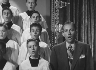 Bing Crosby sings with some hopefully well-behaved choir boys in this 1948 clip.